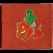 Christmas decoration gummed seals depicting a Teddy bear riding a toy Elephant - Dennison Company mid Century