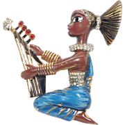 "Corocraft enameled ""Egyptian girl Playing Harp"" brooch/pin designer Adolph Katz - Coro Company 1942"