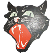 Medium size snarling black Cat face die cut made by Dennison Company 1927