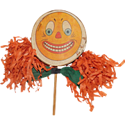 Jack O' Lantern Larger size clown Face Halloween Drum Shaker Noisemaker with crepe paper fringe & bow tie Germany 1930s