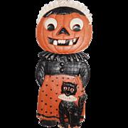 Large vintage German die cut embossed Jack O Lantern Maid with black cat Halloween decoration