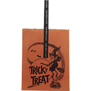Vintage Trick or Treat paper bag sack with Scary Witch Halloween decoration
