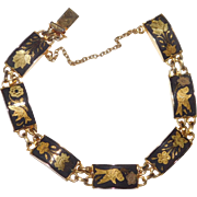 Vintage Link bracelet gold plated enamel featuring birds and flowers Monet Company 1970's