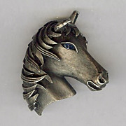 Trifari Horse head brooch with sapphire colored eye - 1960's