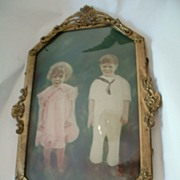 Cutest Kids Hand Colored Photograph in Metal Oval Frame with Bubble Glass.