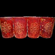 Four Antique Cranberry Glass Tumblers