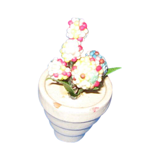 Miniature flowers in wooden pot c 1920-30's