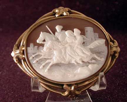 Large Victorian cameo of 3 people on horseback with castle