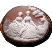 Cameo of 2 women with a dog