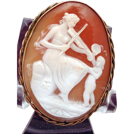 Fine Terpsichore and cherub violin cameo