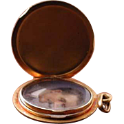 Nice gold locket with hand painted miniature