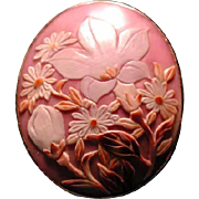 Purple cowrie shell cameo of flowers
