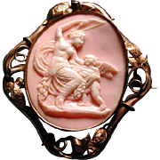 Huge pink conch cameo of Venus and Eros