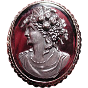 Unique amethyst and silver cameo