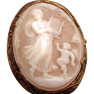 Cameo of muse dancing with cherub