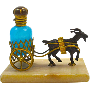 Palais Royal French 19th Century Dore Bronze Goat Cart Pulling a Blue Opaline Glass Scent Bottle all on a Marble Base.