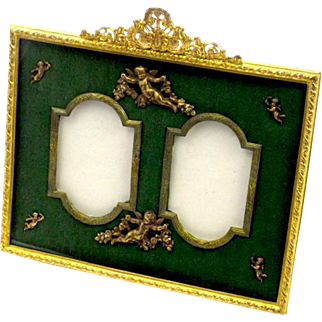 Antique Napoleon III Green Silk and Dore Bronze Double Frame Depicting Cherubs and Classical Swags.