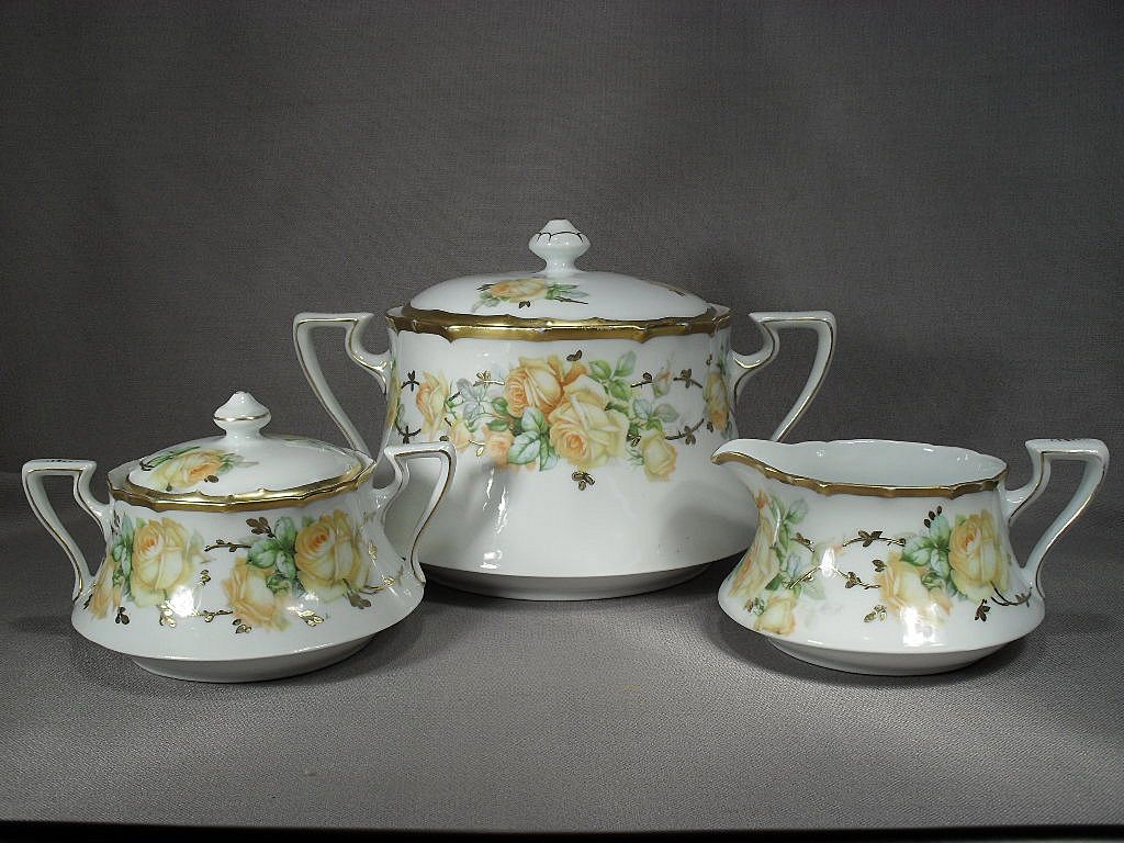 3 Piece of German porcelain. Biscuit or Cracker Jar, Cream and Sugar. Gorgeous Yellow Roses