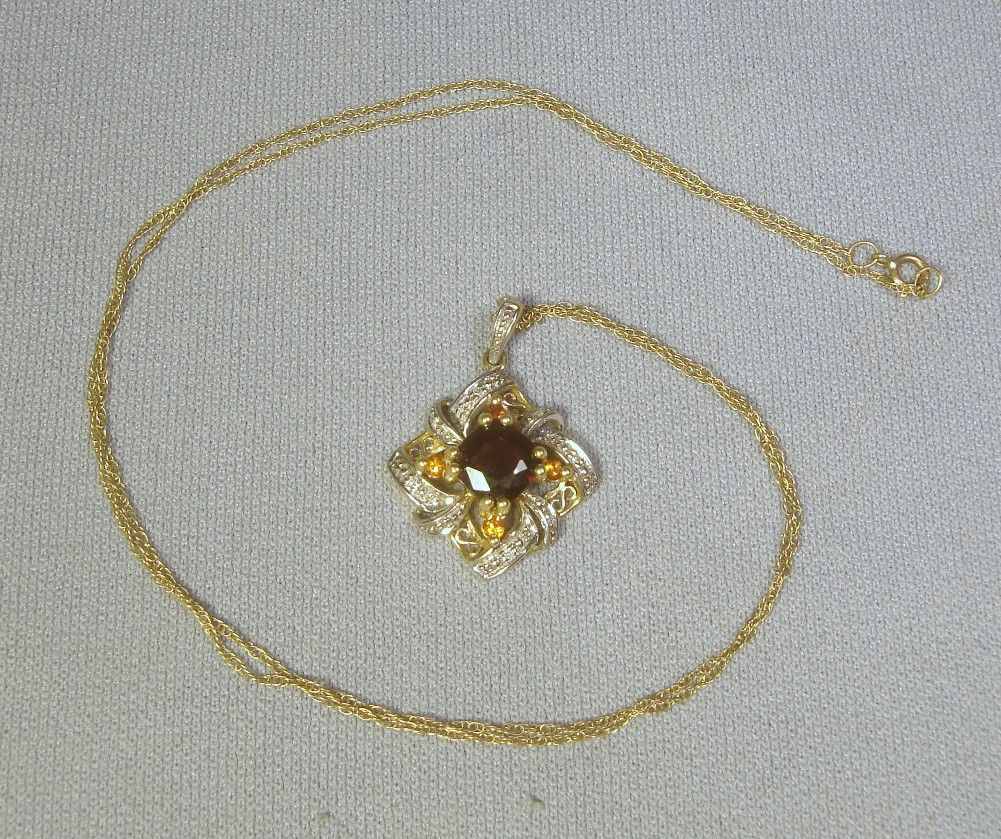 "10k Garnet & Diamond Pendant on 18"" 10k Chain"