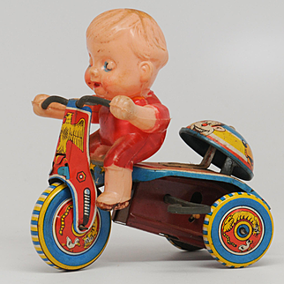 Vintage Boy on Tricycle tin and Plastic or Celluloid Wind up Toy Japan