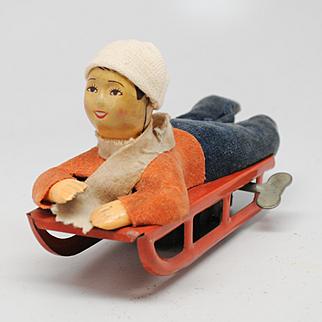 Vintage Wind Up Boy on Sled or Toboggan Japan