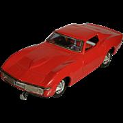 Taiyo Corvette Bump-n-go battery operated tin toy car