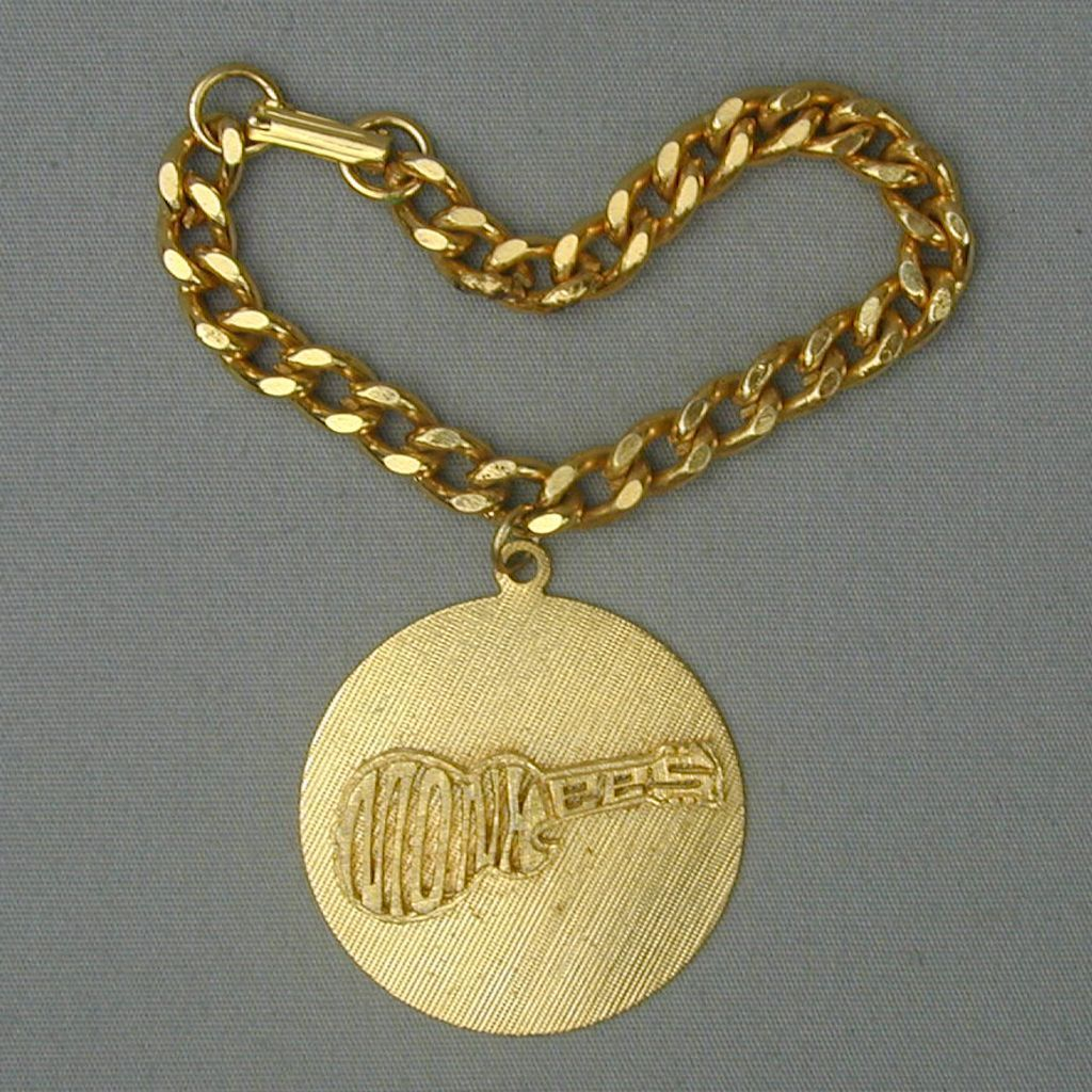 Original 1960s MONKEES Goldtone Disk Charm Bracelet