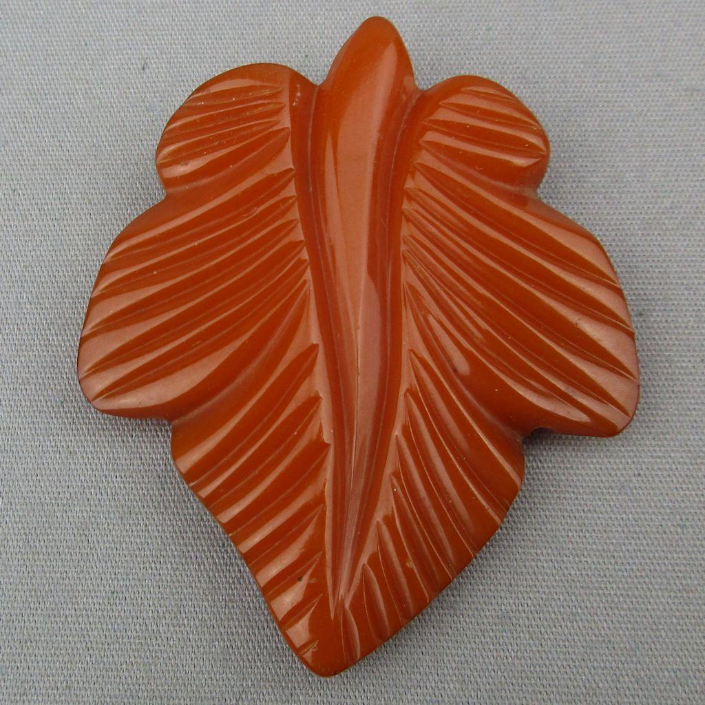 Old 1930s Orange Bakelite Dress Clip - Very Carved