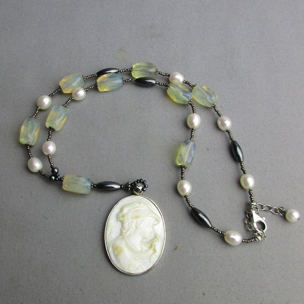 Carved Mother-of-Pearl Cameo Girl Necklace Showing Off Her Pearls