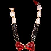 Unique 1980s Lucite Red Bow Bead Necklace