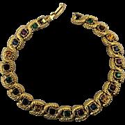 Slinky Gold-Tone Bracelet w/ Jewel Color Rhinestone Links
