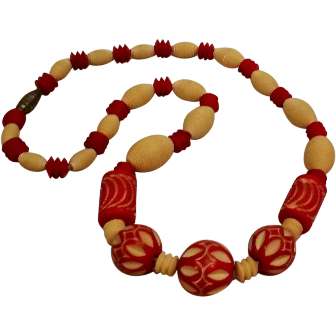 Carved celluloid bead necklace Art Deco red cream