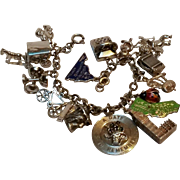 Sterling  bracelet sixteen charms enamel ladybug, state, phone, imp, lobster, etc