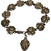 Sterling bracelet roses religious medals St Theresa, Mary, Jesus, St Christiopher, etc