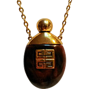 Givenchy perfume pendant necklace toroise shell lucite 1977