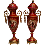 Hand painted French porcelain covered urns signed brass mounts