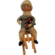 Antique German Heubach cotton bisque boy Christmas ornament sled googly eyes