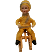 Cotton bisque face Heubach Christmas ornament Germany boy on sled