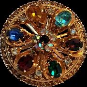 Warner rhinestone flower wheel pin