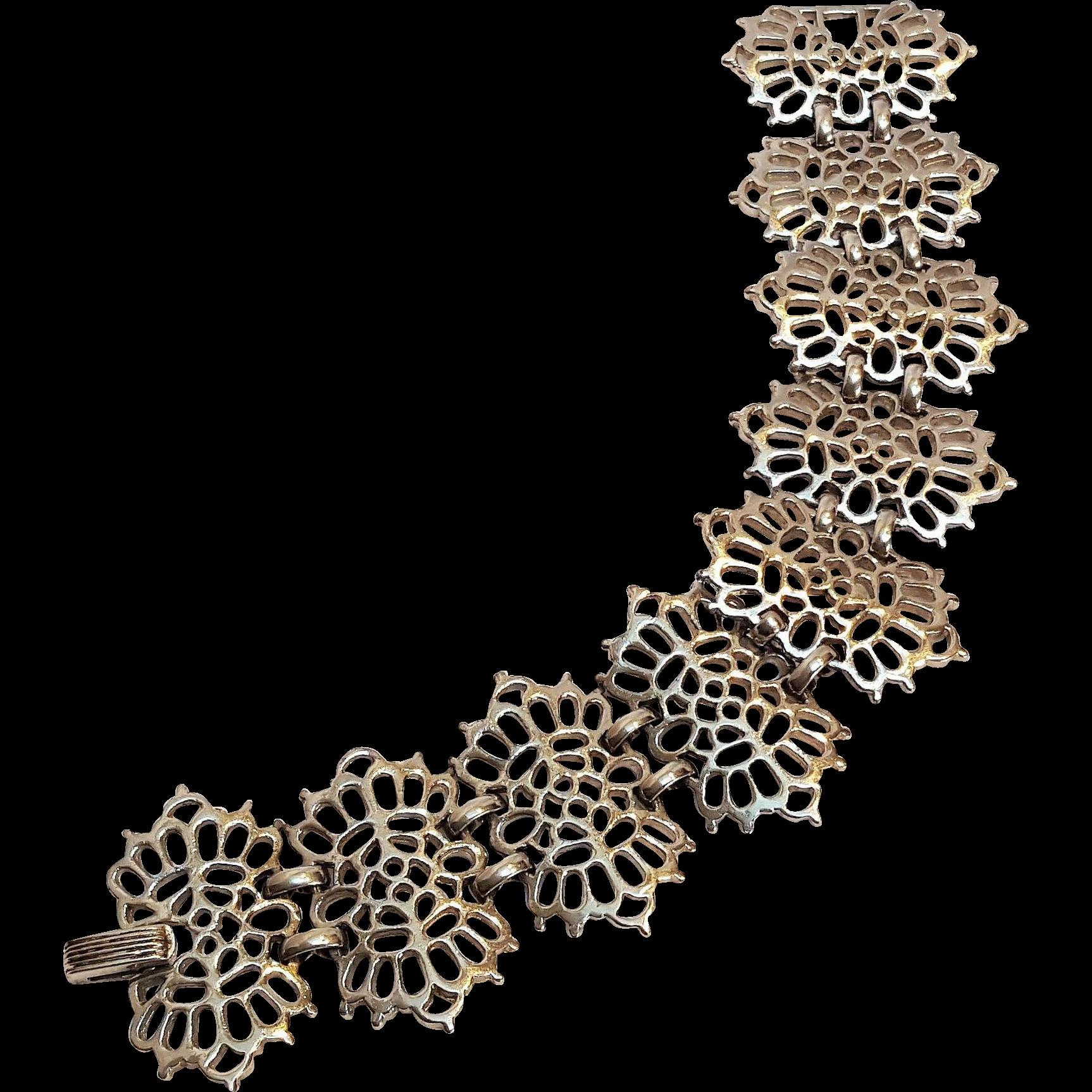 Trifari open work plaque bracelet silver tone