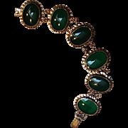 Sterling bracelet green stones signed ND