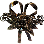 Sterling silver bouquet of flowers pin with bow