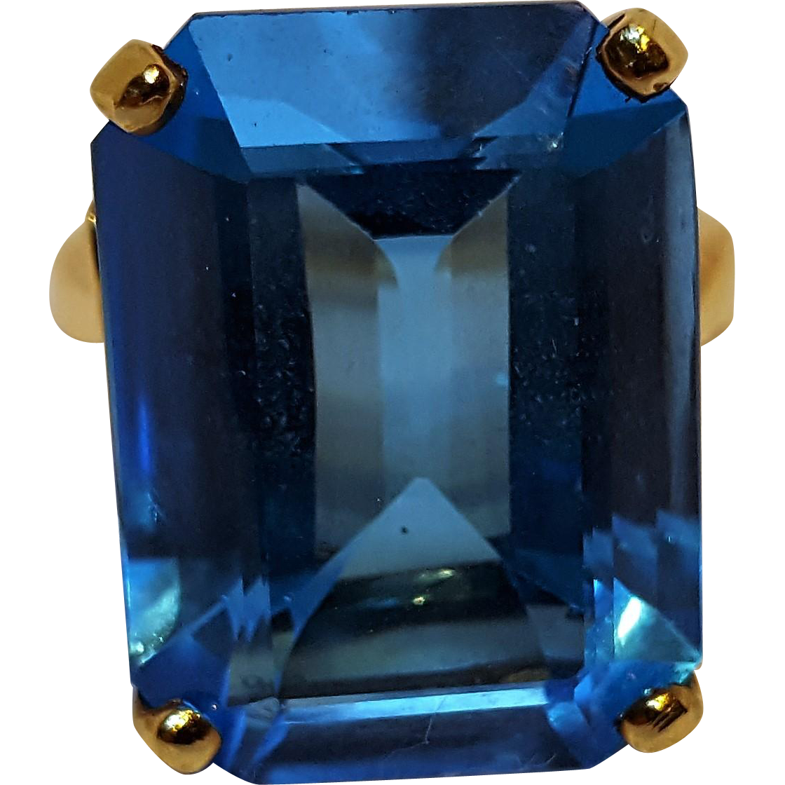 10K gold blue topaz  ring emerald cut