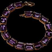 10K Gold amethyst tennis bracelet Clyde Duneier emerald cut