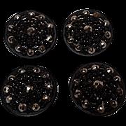 Antique Japanned metal cut steel buttons four