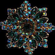 Rhinestone starburst pin green blue aurora borealis