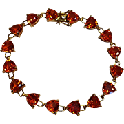 10K Gold trillion cut orange sapphire tennis bracelet