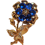 Pot metal blue rhinestone flower pin