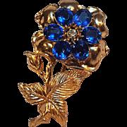 Pot metal blue rhinestone flower pin