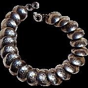 Southwest Sterling silver stamped disc bead bracelet